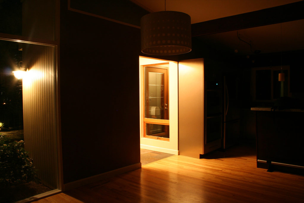A lit doorway in a dark wall