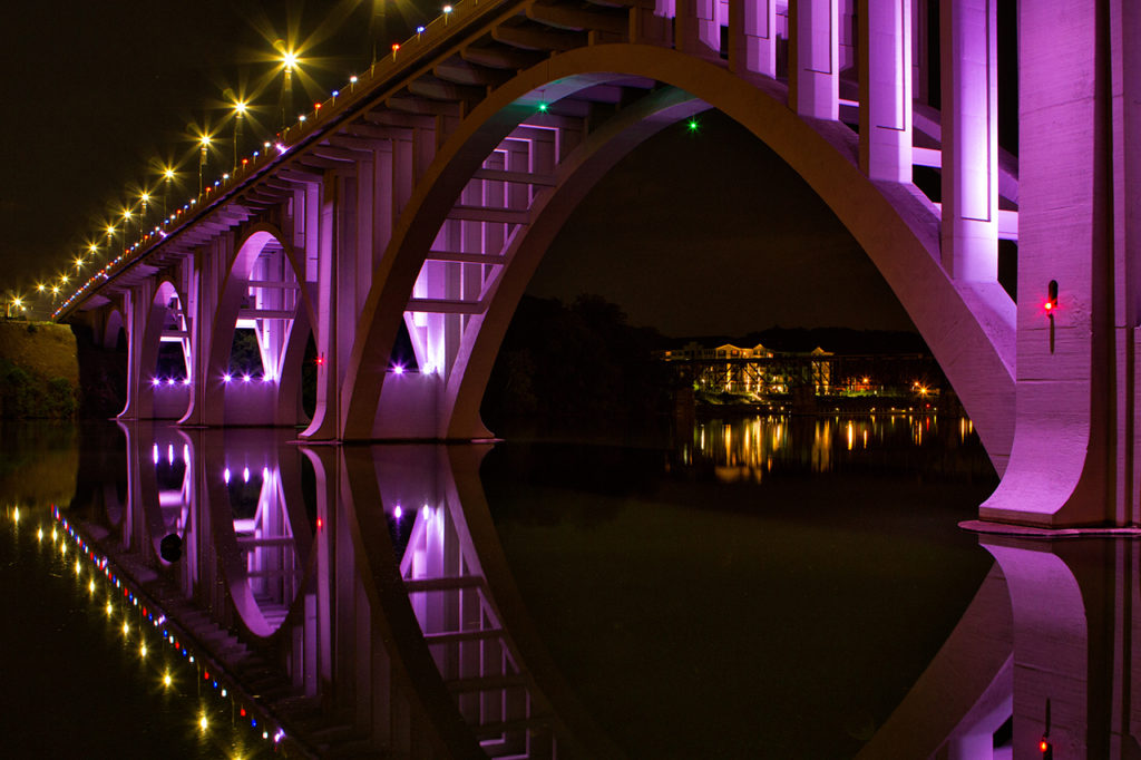 Beautifully lit purple bridge at night in Knoxville Tennessee