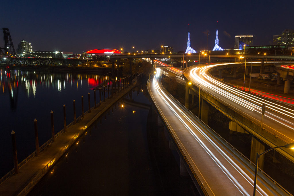Long exposure night shot of Portland Oregon waterfront and freeways with blurred headlights