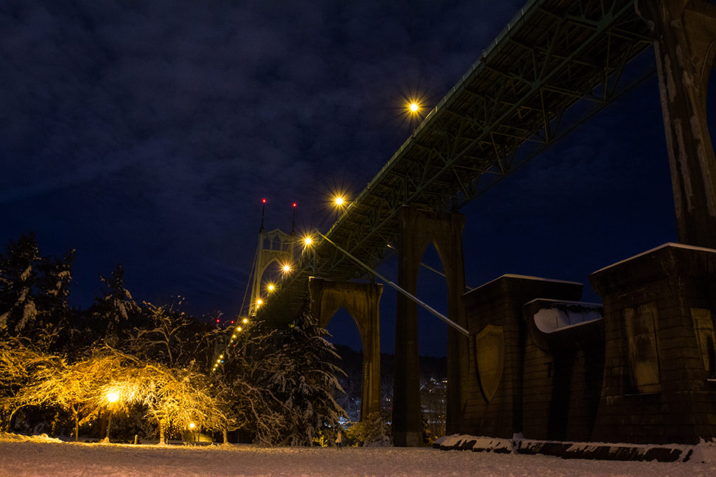 Looking up at St Johns bridge in Portland Oregon during snowy winter