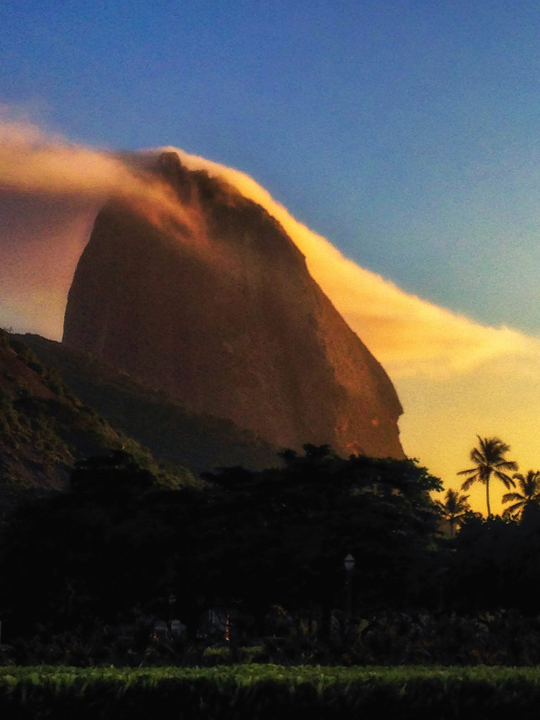Ethereal clouds at sunrise race over the famed Sugarloaf at Rio de Janeiro in Brazil