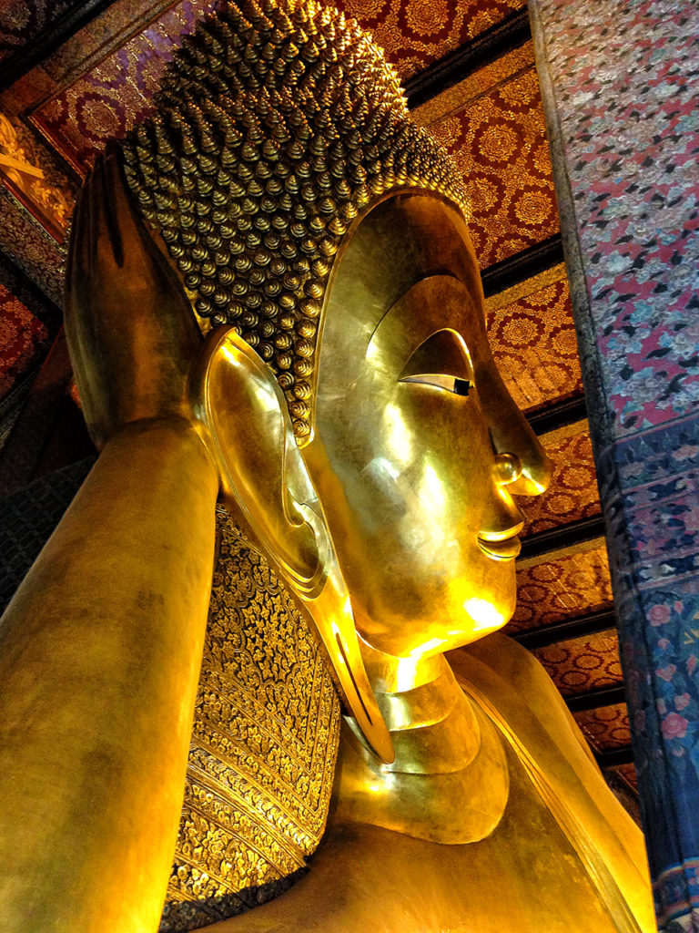 Close upshot of the gigantic 45 meter long Reclining Buddha at Wat Pho in Thailand