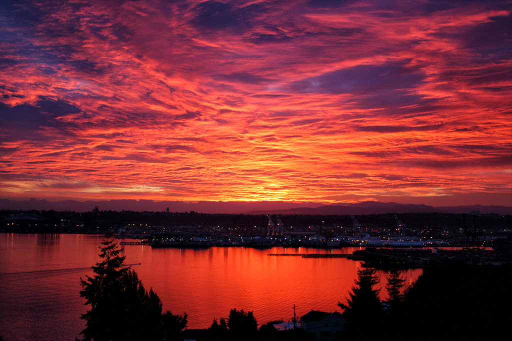 Brilliant sunrise with vivid clouds over Seattle harbor