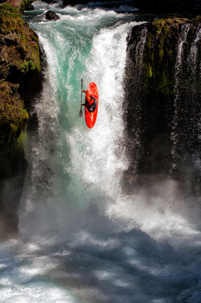 Whitewater kayaker drops over 40 foot falls into churning water below